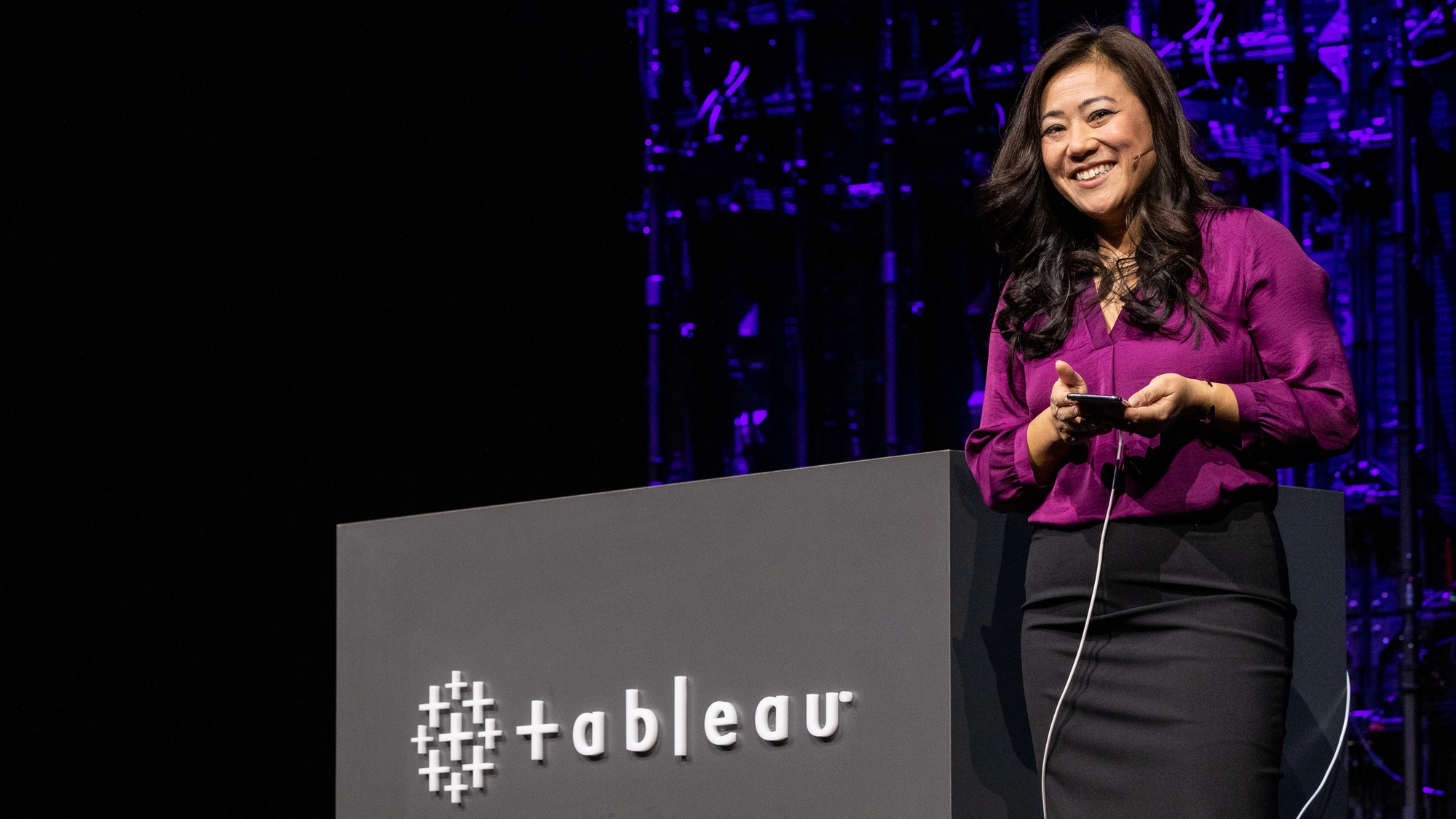 Product manager Ann demos Metrics on Tableau Mobile on stage at TC19