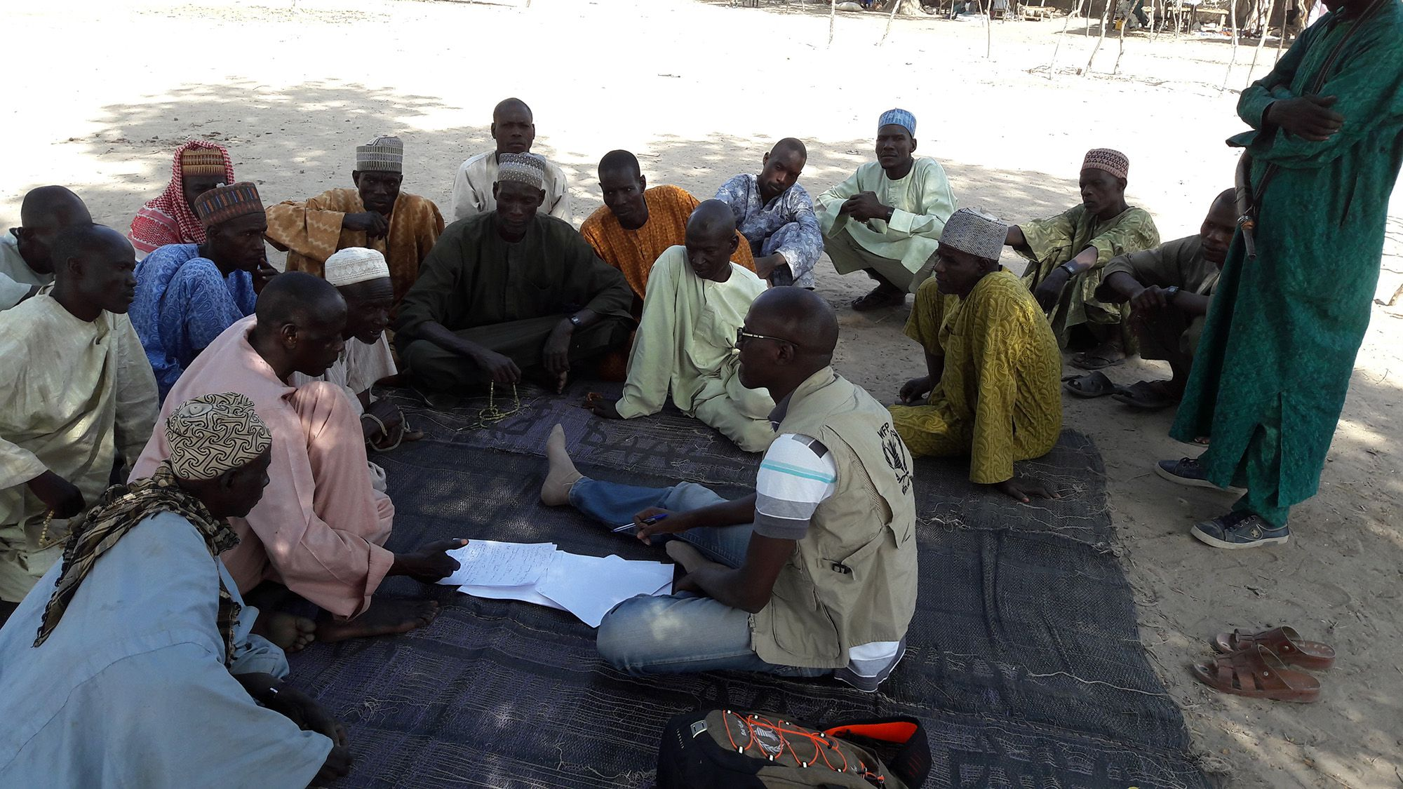 WFP's Moutapha Toure conducts Vulnerability Analysis and Mapping interviews in a village near Maiduguri, Nigeria